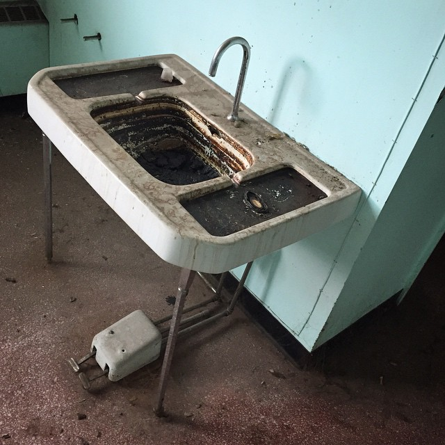 The power was out at work, so I explored all of the scary areas of the building.  I love this sludge sink.  #spooky